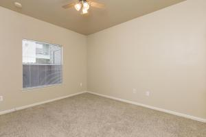 Bedroom with carpeted floors and ceiling fan