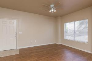 Large apartment living room with ceiling fan