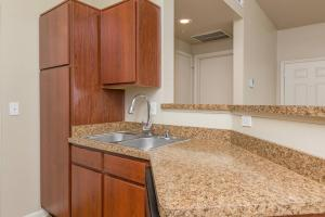Stainless steel sink, pantry, and counter-space in galley-style kitchen