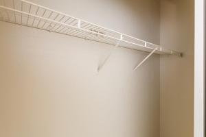 Walk-in closet with shelves for extra storage