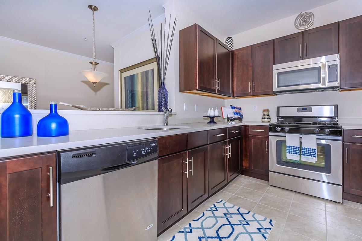 DESIGNER KITCHEN WITH CUSTOM CABINETRY AND QUARTZ COUNTERTOPS