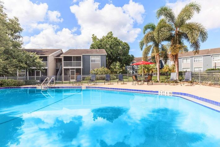 Cool off in the swimming pool at Arbor Oaks Apartments in Bradenton, Florida.