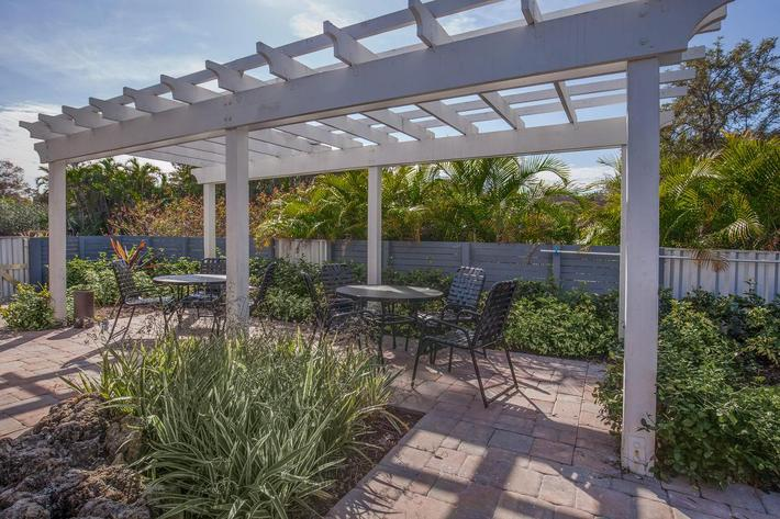Enjoy the picnic area at Arbor Oaks Apartments in Bradenton, Florida.