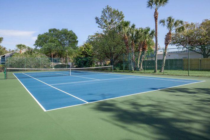 Exercise at the tennis court at Arbor Oaks Apartments in Bradenton, Florida.