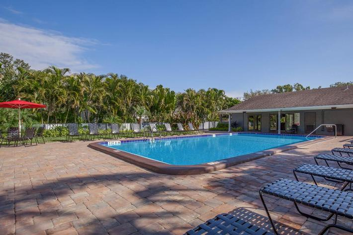 Go for a swim in the shimmering swimming pool at Arbor Oaks Apartments in Bradenton, FL.