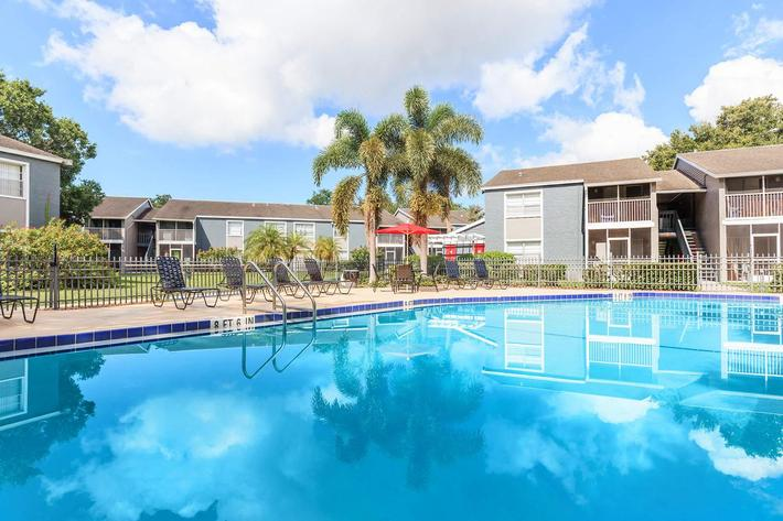Relax by the shimmering swimming pool at Arbor Oaks Apartments in Bradenton, FL.
