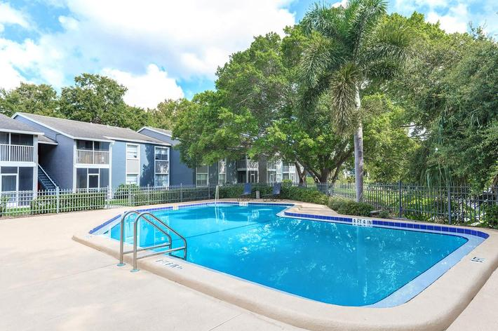 Shimmering swimming pool at Arbor Oaks Apartments in Bradenton, Florida.