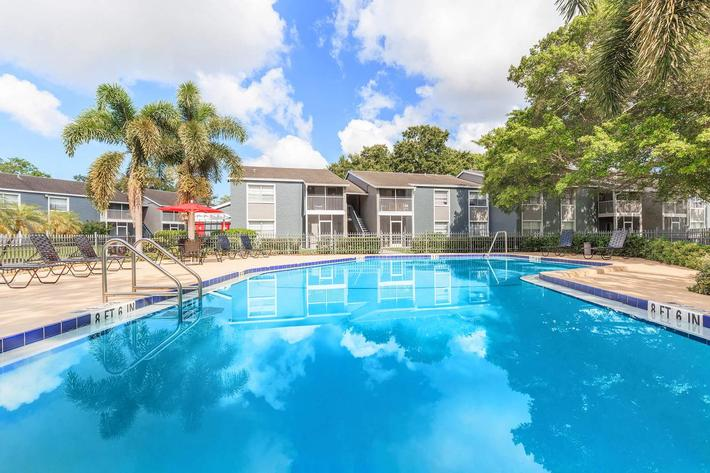 Soak up the sun in the swimming pool at Arbor Oaks Apartments in Bradenton, Florida.