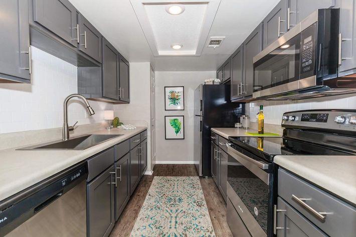 Modern kitchens at Arbor Oaks Apartments in Bradenton, Florida.