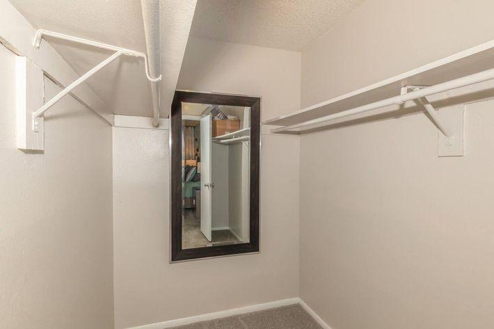 Spacious walk-in closets at Arbor Oaks Apartments in Bradenton, FL.