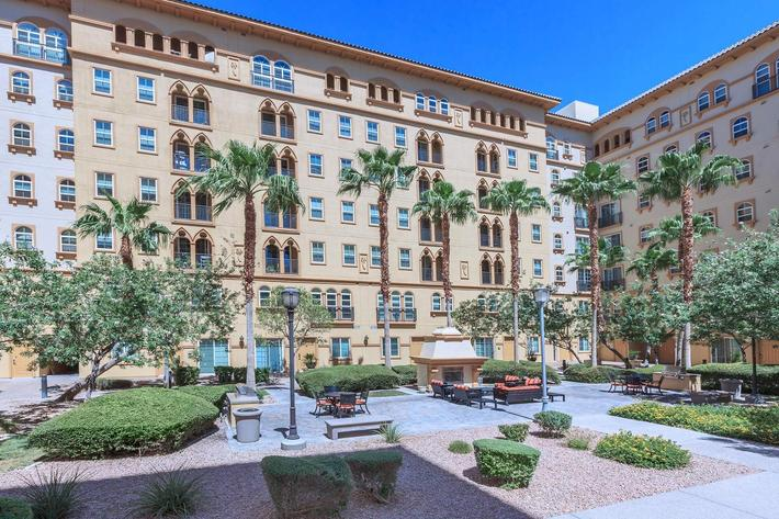 GATHER WITH FRIENDS AROUND THE FIREPLACE IN THE COURTYARD AT BOCA RATON IN LAS VEGAS, NEVADA