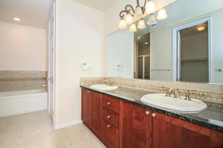 BATHROOM WITH A TWO SINK VANITY AT BOCA RATON IN LAS VEGAS, NEVADA