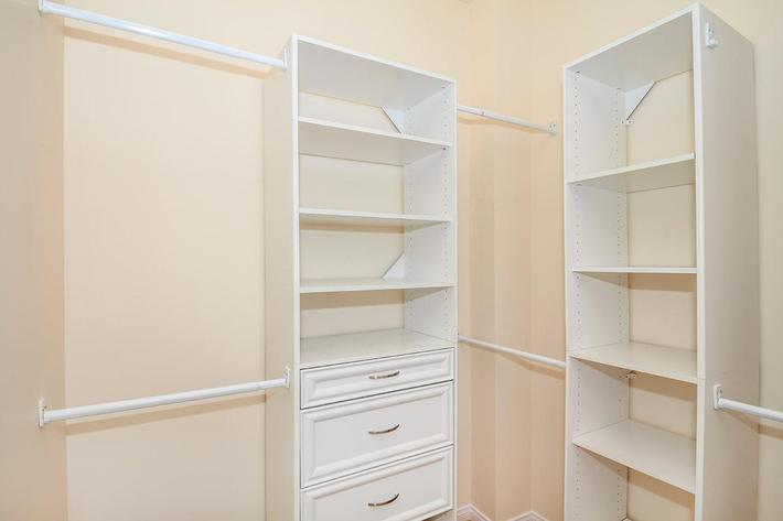 Walk-in closets with built in shelving at Boca Raton