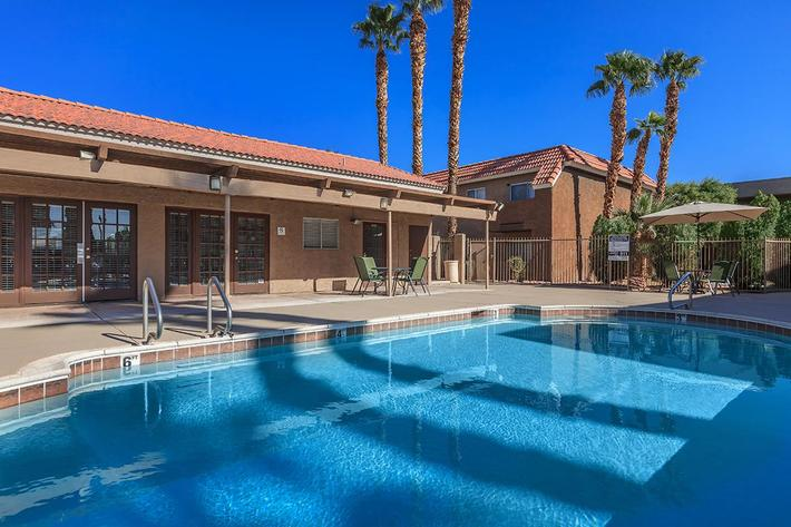 TAKE A DIP IN OUR SHIMMERING SWIMMING POOL AT BELLA ESTATES APARTMENT HOMES IN LAS VEGAS, NEVADA