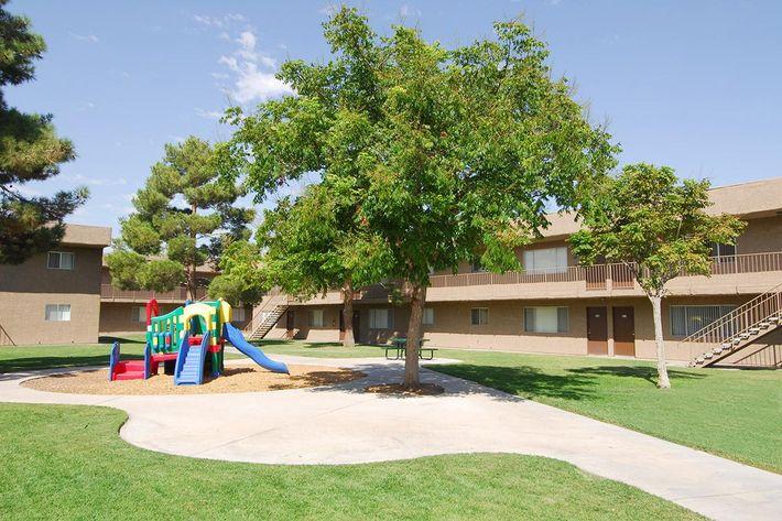 Childrens play area at Bella Estates Apartment Homes