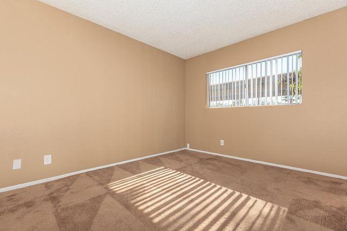 COMFORTABLE BEDROOM AT BELLA ESTATES APARTMENT HOMES IN LAS VEGAS, NEVADA