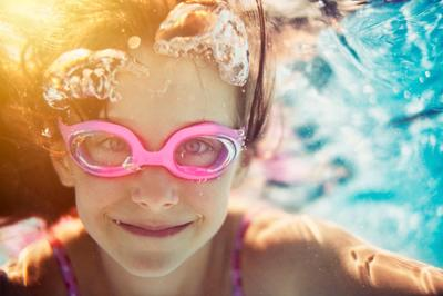 Little girl swimming underwater iStock_000054790392_Large.jpg