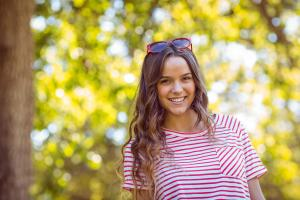 Pretty brunette smiling in the park iStock-482560614.jpg